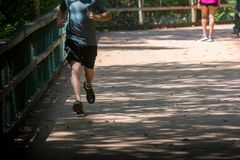Man Running on Walkway in the Park in a Hot Day. On Blur Background. Turkey Creek, Niceville, Florida royalty free stock images