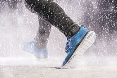 Man running in winter Stock Photos