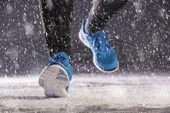Man running in winter Stock Photos
