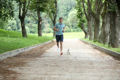 Man running with your dog Stock Photos
