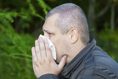 Man with a runny nose. And napkin Stock Photos