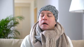 Man Runny Nose Using Nasal Spray And Sneezes Loudly. stock footage