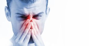 Man with runny nose on white background, in blue toning, ill with laryngitis. Man with runny nose on white background, in blue toning, ill with royalty free stock photo