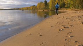 A man runs along the sandy beach. Early in the morning at dawn. He plays sports and leads a healthy life. 4K stock footage