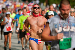 Man Runs Atlanta Road Race Wearing Patriotic Bikini Stock Photo