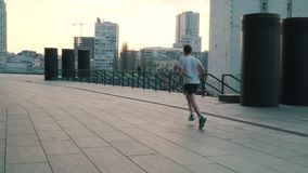 Man runs in the city.  stock footage