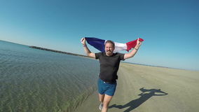 A man runs holding a flag of France stock footage