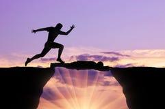 Man runs through a man lying on precipice. Concept of competition Stock Photo