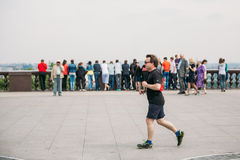 Man runs past the passers in Sparrow Hills, Moscow Royalty Free Stock Photo