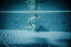 Man runs underwater swimming pool Royalty Free Stock Images