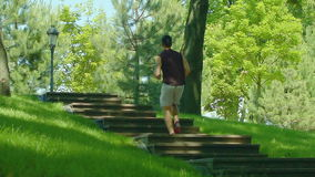 Man runs up stairs in slow motion. Cardio exercise outdoor. Male runner stock footage