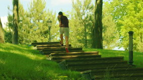 Man runs up stairs in slow motion. Fitness man running up stairs stock video
