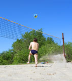 Man runs after volley ball Stock Photography