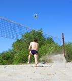 Man runs after volley ball Stock Photography