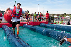 Man Runs Through Wrecking Balls At Crazy Obstacle Race Stock Images