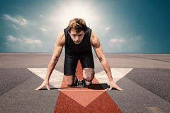 Man runway airport start. Male athlete on airport runway preparing for his start Royalty Free Stock Photo
