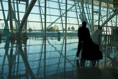 Man rushing at airport. Man rushing through an airport terminal stock photography