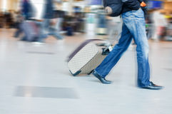 Man rushing to catch his flight in airport Royalty Free Stock Image