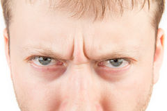 Man's angry eyes Stock Image