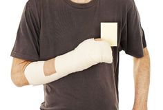 Man's arm in cast holding a blank card Stock Image