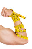Man's arm wrapped in measuring tape showing. Muscles concept of healthy diet excercise isolated on white Royalty Free Stock Image