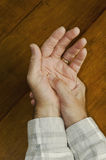 Man's arthritic hands. Man rubbing massaging his own hand Stock Images