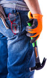 Man's back with tools in hand hammer Stock Images