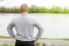 Man's back. Training outdoor loking on river. Stock Image
