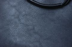Man`s bag of artificial black leather. Fragment of a man`s bag of artificial black leather royalty free stock photography