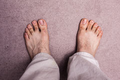 Man's bare feet on carpet Royalty Free Stock Photo