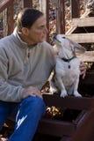 Man Kissing Dog Stock Photo