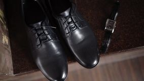 Man`s black shoes. And wrist watch stock video footage