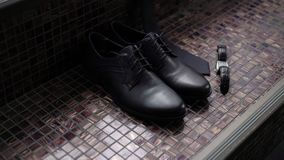 Man`s black shoes. And wrist watch stock video