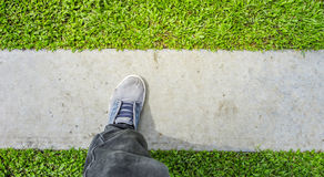 Man's blue shoes stand on floor Royalty Free Stock Image