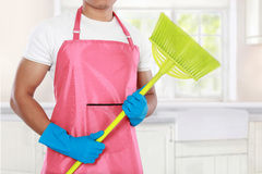 Man's body with broom cleaning equipment Royalty Free Stock Photography