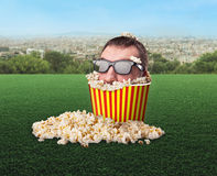 Man's in a bucket of popcorn Stock Images