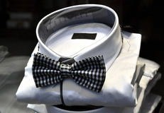 Man's business white shirt with bowtie. Luxury shop Stock Photography
