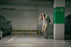 Man`s car was stolen, can`t find car at underground parking Royalty Free Stock Image