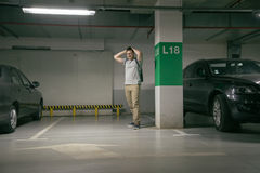 Man`s car was stolen, can`t find car at underground parking Stock Photo