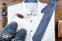 Man`s classic clothes outfit flat lay with formal shirt, tie, shoes and accessories. Top view Stock Photo