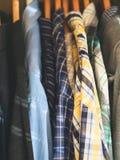 Man`s closet hangers shirts closeup. Man`s closet. Hangers with shirts closeup. Male wardrobe royalty free stock images