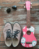Man's clothing, sunglasses, and shoes lay on wood vintage background, Royalty Free Stock Image