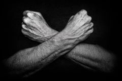 Man with crossed arms on dark Stock Image