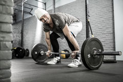 Man's crossfit workout with barbell Stock Photography