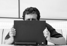 Man's eyes over laptop Royalty Free Stock Photo