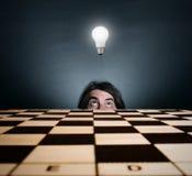 Man's face and burning light bulb. Stock Photos