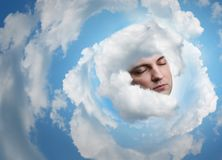 Man's face in clouds Stock Photos