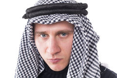 Man's face covered with Arab scarf Stock Images