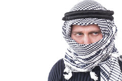 Man's face covered with Arab scarf Royalty Free Stock Images