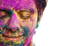 Man's face covered with powder paint during Holi festival. Close-up of man's face covered with powder paint during Holi festival stock images